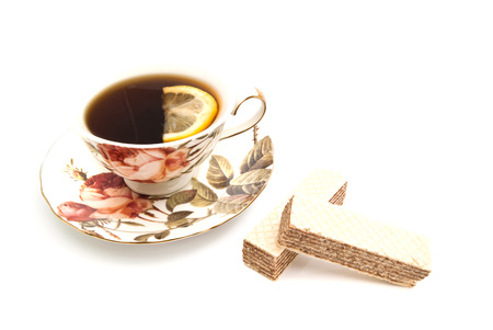 coffeecup: wafers and cup of tea with lemon on white