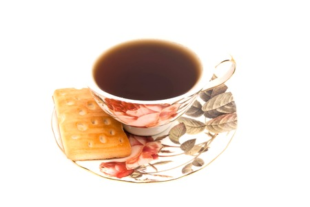 cup of tea and delicious cookie on white background Stock Photo