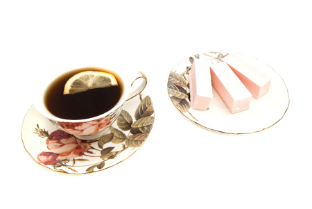 coffeecup: sweet paste and cup of tea with lemon on white background