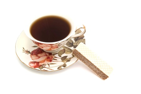 coffeecup: wafer and cup of tea on white background Stock Photo