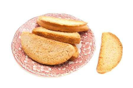 heap of crackers on glass plate on white Stock Photo