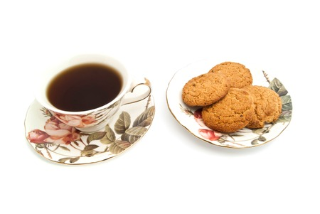 coffeecup: cup of tea and oatmeal cookies closeup on white