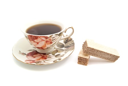 coffeecup: pair of wafers and cup of tea on white closeup Stock Photo