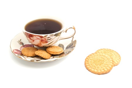 coffeecup: cup of tea and different cookies on white background