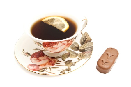coffeecup: cup of tea with lemon and chocolate bar closeup on white background Stock Photo