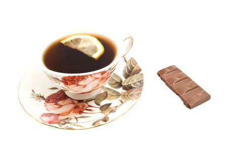 coffeecup: cup of tea with lemon and chocolate on white background Stock Photo