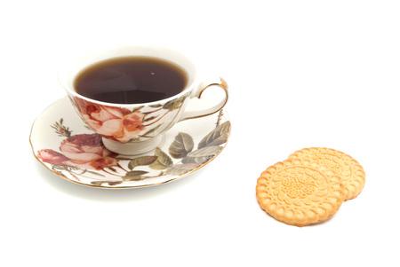 coffeecup: mug of tea and cookies on white closeup