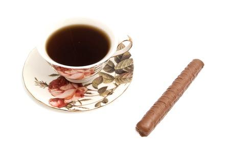 coffeecup: cup of tea and chocolate bar on white
