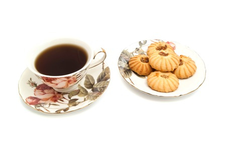 coffeecup: plate with cookies and cup of tea on white