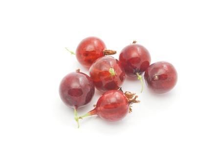 gooseberries: tasty red gooseberries closeup on white background