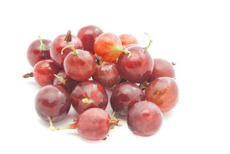 gooseberries: heap of red gooseberries closeup on white