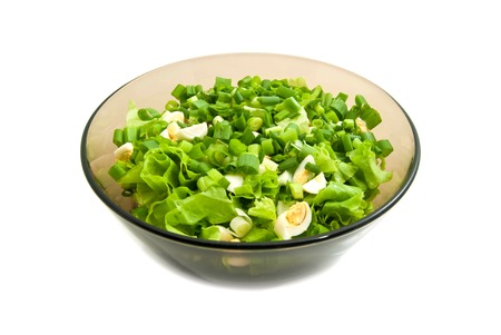 glass plate: vegetable salad in glass plate on white