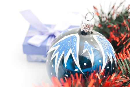 blue gift box: christmas tree toy, blue gift box and tinsel on white closeup