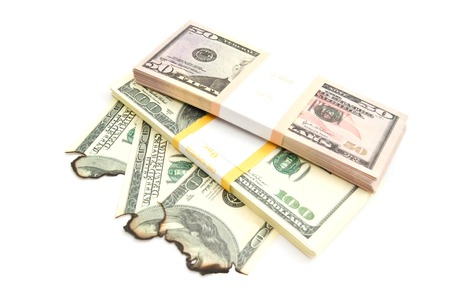 pack of dollars: pack of dollars and burned dollars banknotes Stock Photo