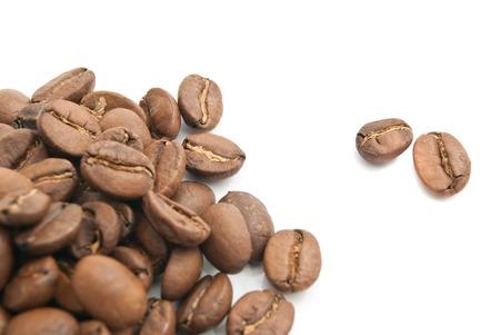 heap: heap of coffee beans on white closeup Stock Photo