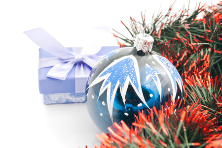 blue gift box: christmas tree toy, blue gift box and tinsel on white Stock Photo
