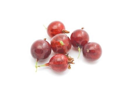 gooseberries: tasty red gooseberries on white background closeup Stock Photo