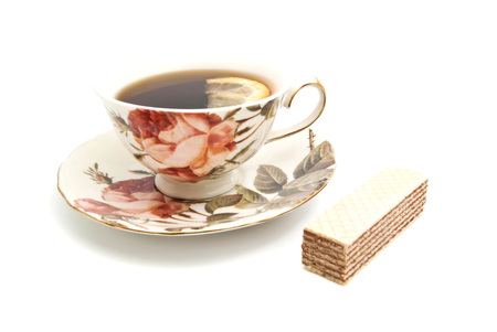 coffeecup: wafer and cup of tea with lemon on white Stock Photo