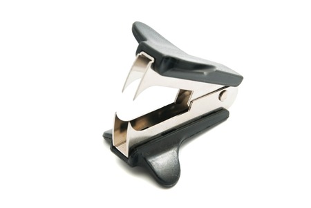 staple: black staple remover closeup on white background