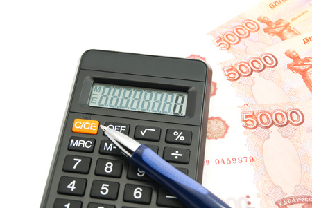 rubles: rubles banknotes, calculator and pen on white background