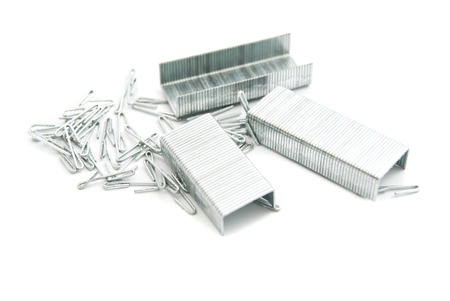 heap: heap of metal staples on white background