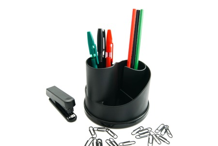 paper clips: stapler, paper clips and other stationery on white
