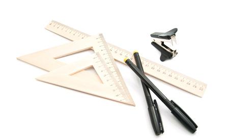 staple: staple remover, black pens and ruler on white