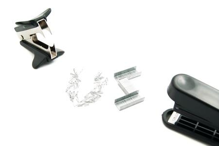 remover: staple remover and plastic stapler on white background