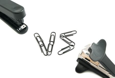 staple: staple remover and stapler on white background closeup