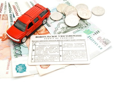 afford: red car, driving license and banknotes on white