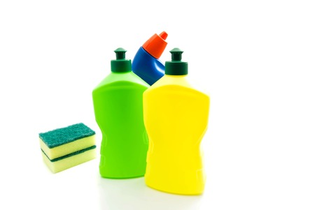 sterilize: three different bottles of detergent and sponges closeup on white Stock Photo