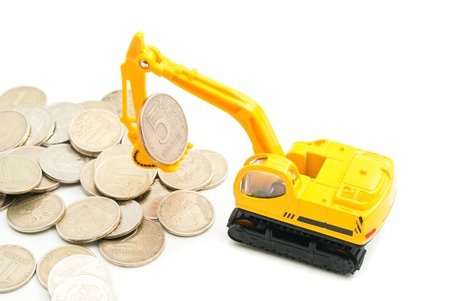 afford: russian coins and yellow backhoe on white closeup Stock Photo