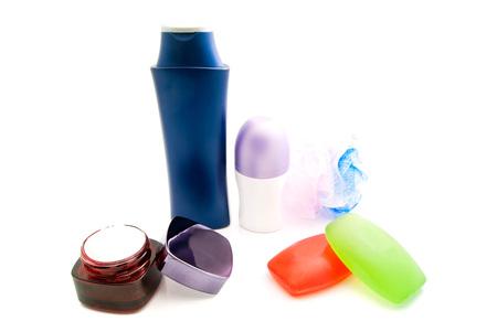 moisturiser: wisp and other toiletries on white background