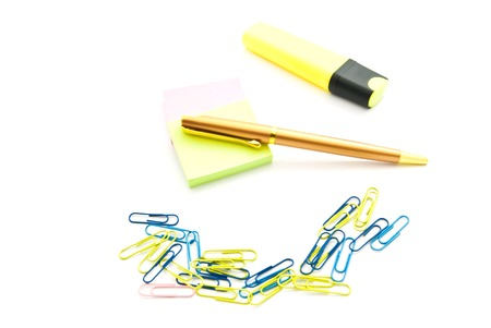 paper clips: stickers, pen, paper clips and marker on white