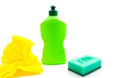 sterilize: green sponge, bottle and rag on white
