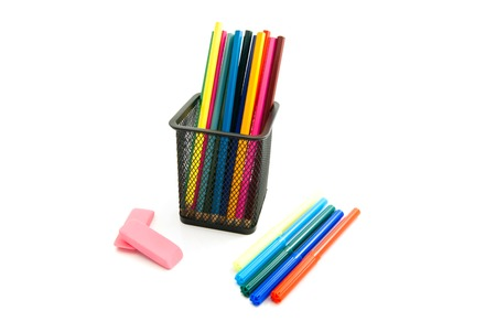 erasers: colorful pencils, markers and erasers on white background