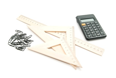paper clips: ruler, calculator and paper clips on white