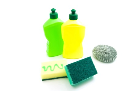different sponges and two bottles on white