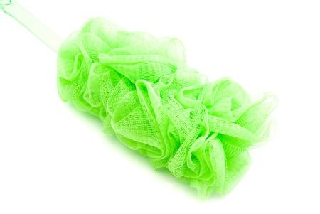 wisp: green wisp with plastic handle on white Stock Photo