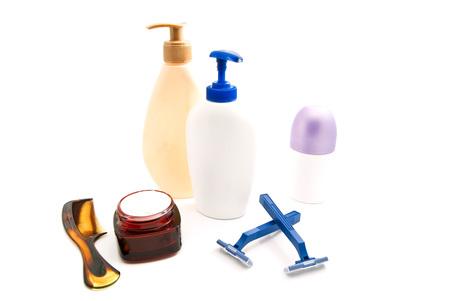 moisturiser: shower gel, cream, razors and comb on white