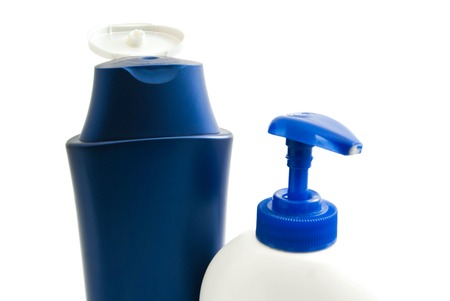 moisturiser: two bottles with shampoo and gel on white