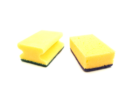 housework: two yellow sponges for housework on white