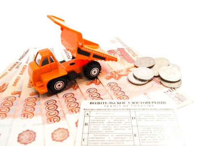 afford: truck, driving license and banknotes on white closeup
