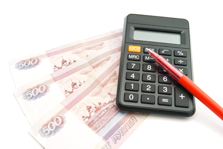 red pen: Russian banknotes, red pen and calculator on white