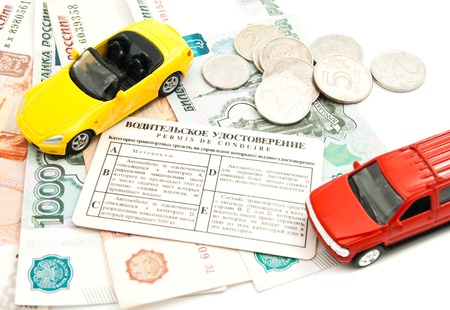 auto leasing: different cars, driving license and banknotes closeup on white