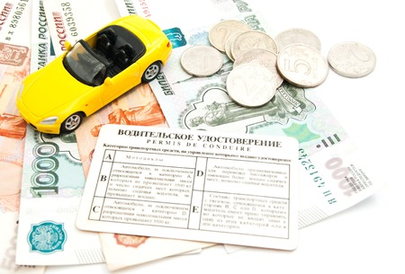 afford: yellow car, driving license and banknotes on white
