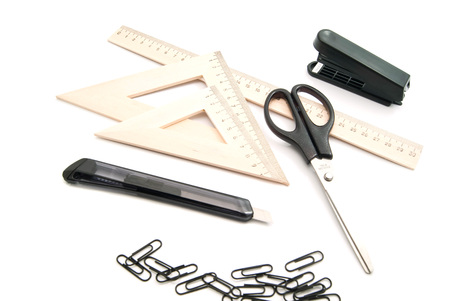 scissors, stapler and other stationery on white background