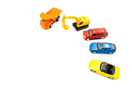 afford: orange truck, backhoe and other cars on white background