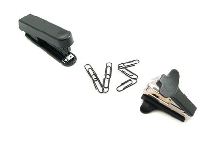 remover: staple remover and stapler on white background