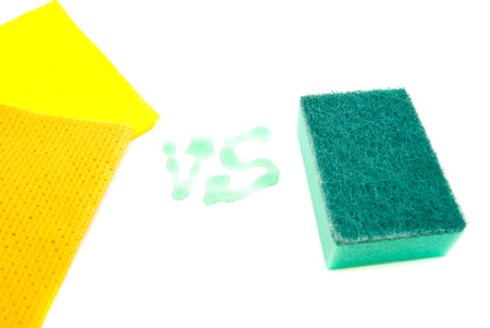 two rags and sponge on white background closeup Stock Photo